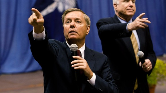 Graham, left, and McCain call on participants during a health care town hall meeting on September 14, 2009 at the Citadel in Charleston, South Carolina. According to his website, Graham is a native South Carolinian and grew up in a blue collar family in the small town of Central, where his parents ran a restaurant and pool hall.