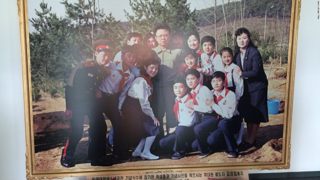 A photo of late North Korean leader Kim Jong Il posing with students sits in the lobby of a Pyongyang elementary school.