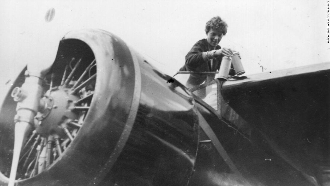 Earhart is seen in the cockpit of her single-engine Lockheed Vega 5B. Earhart was born in 1897 in Atchison, Kansas. She learned to fly after she was inspired by an airplane ride at an air show in 1920. She was the 16th woman to receive a pilot's license from the Federation Aeronautique Internationale.