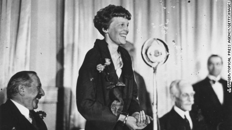 Amelia Earhart addresses journalists during lunch at the Criterion, London, in May 1932.