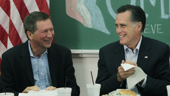 Kasich, left, and then-Republican presidential candidate Mitt Romney  talk with students during a roundtable discussion at Otterbein University on April 27, 2012 in Westerville, Ohio. Romney eventually won the 2012 GOP presidential nomination.