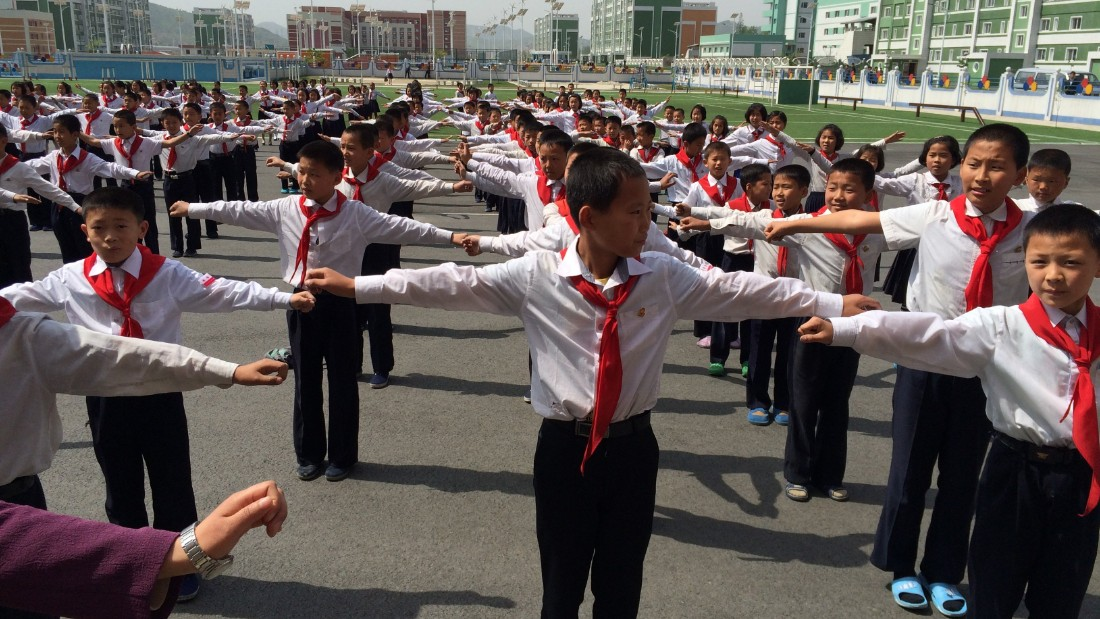 Outdoor exercise accompanied by upbeat music is a daily routine for these North Korean middle school students. Afterward, classes are critiqued on their coordination.