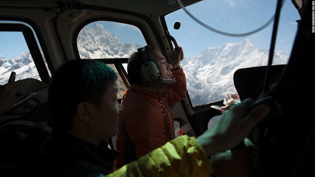 Phurba Sherpa anxiously peers out the window of a helicopter ferrying him to a remote Sherpa village high in the Himalayas. He wanted to assess the damage wrought by the April 25 earthquake in Nepal.