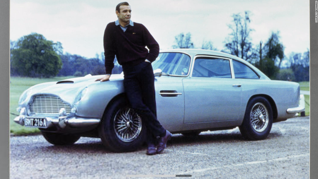 Prepare to pay between $3,800 and $4,600 for this fine photograph of James Bond with the DB5 at the Stoke Poges Golf Club, with autographs of Ian Fleming, David Brown and Sean Connery, measuring 83 x 111 cm overall.
