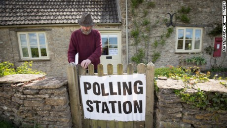 A voter enters a polling station located in the Old Post Office in the village of Brokenborough near Malmesbury on May 7, 2015 in Wiltshire, England