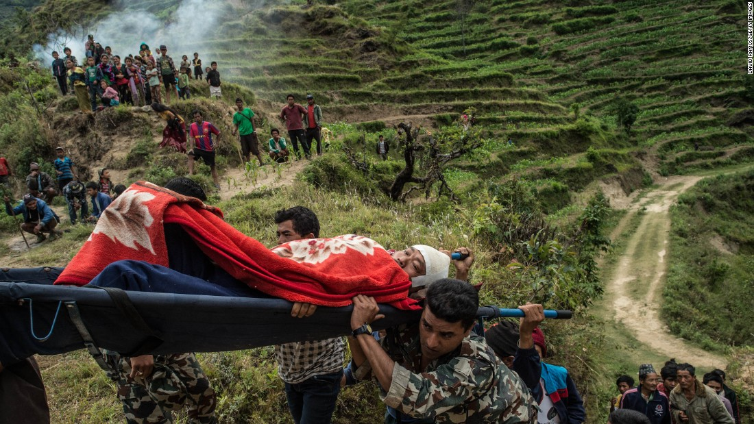 "Villagers and soldiers carry an injured Nepalese man toward an Indian army helicopter after he was injured during an aftershock in Lampuk, Nepal, on Wednesday, May 6. <a href=""http://www.cnn.com/2015/04/25/world/gallery/nepal-earthquake/index.html"" target=""_blank"">A magnitude-7.8 earthquake</a> centered less than 50 miles from Kathmandu rocked Nepal with devastating force Saturday, April 25. The earthquake and its aftershocks have turned one of the world's most scenic regions into a panorama of devastation, killing and injuring thousands."