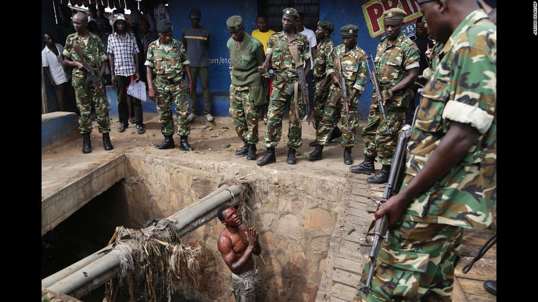 "Jean Claude Niyonzima, a suspected member of the ruling party's Imbonerakure youth militia, pleads with soldiers to <a href=""http://www.cnn.com/2015/05/07/africa/gallery/captured-in-burundi/index.html"" target=""_blank"">protect him from a mob</a> after he came out of hiding in a sewer in the Cibitoke district of Bujumbura, Burundi, on Thursday, May 7. Niyonzima fled from his house into the sewer under a hail of stones thrown by a mob protesting President Pierre Nkurunziza's decision to seek a third term in office."