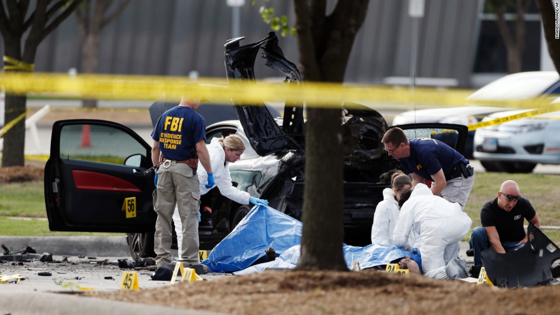 "FBI crime scene investigators document the area around two deceased gunmen and their vehicle in Garland, Texas, on Monday, May 4. <a href=""http://www.cnn.com/2015/05/04/us/garland-mohammed-drawing-contest-shooting/index.html"" target=""_blank"">Police shot and killed the men</a> after they opened fire on a security officer outside the suburban Dallas venue, which was hosting provocative contest for Prophet Mohammed cartoons Sunday night."