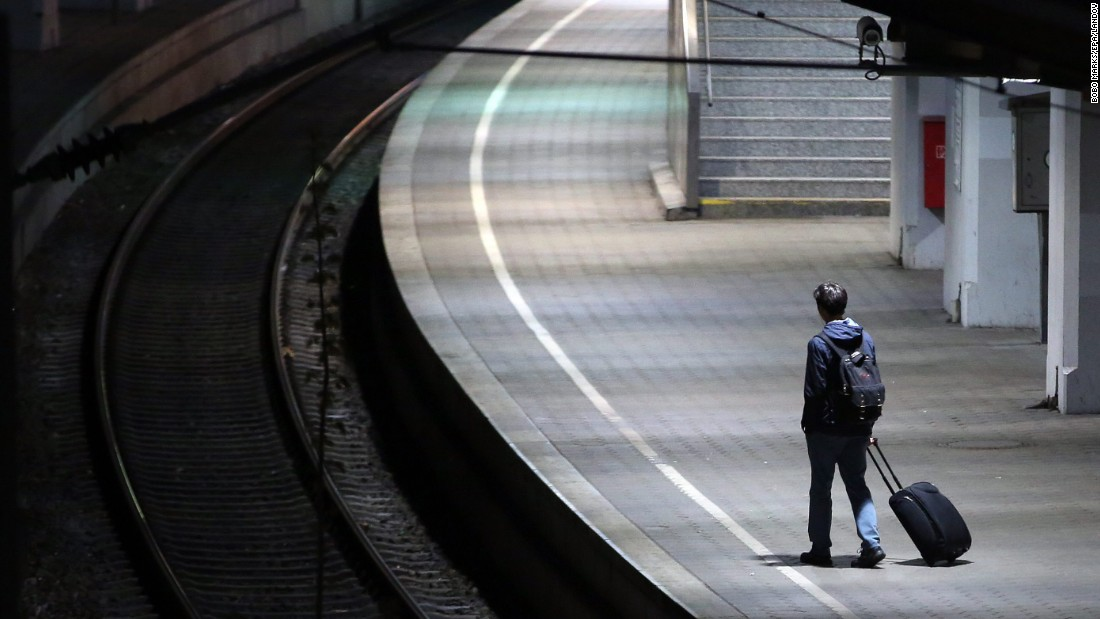 A passenger stands on a platform at the main train station in Hamburg, Germany, on Tuesday, May 5. A weeklong strike by German train drivers began early May 5, with no sign of a breakthrough in negotiations between the drivers' union and their bosses.