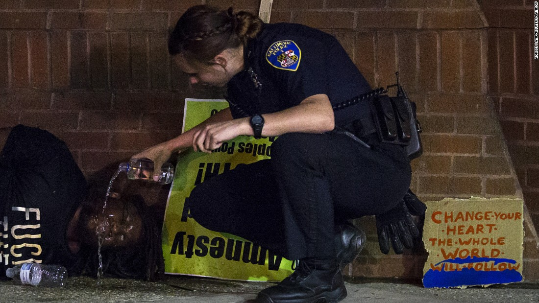 "A police officer douses a detained protester with water after he was hit by pepper spray while <a href=""http://www.cnn.com/2015/04/23/us/gallery/freddie-gray-protest/index.html"" target=""_blank"">defying a curfew</a> in Baltimore on Saturday, May 2. The death of Freddie Gray, who died in police custody, sparked <a href=""http://www.cnn.com/2015/04/30/us/gallery/freddie-gray-protests-across-us/index.html"" target=""_blank"">protests across the country</a>. Demonstrators this week celebrated the May 1 announcement that <a href=""http://www.cnn.com/2015/05/01/us/freddie-gray-baltimore-death/index.html"" target=""_blank"">six officers were charged</a> in Gray's death."