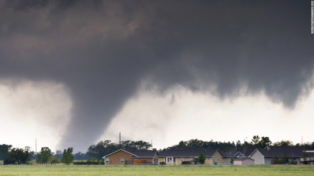 "A tornado touches down just west of Halstead, Kansas, on Wednesday, May 6. The National Weather Service had <a href=""http://www.cnn.com/2015/05/07/us/midwest-severe-weather/index.html"" target=""_blank"">50 reports of tornadoes</a> in Texas, Oklahoma, Kansas and Nebraska."