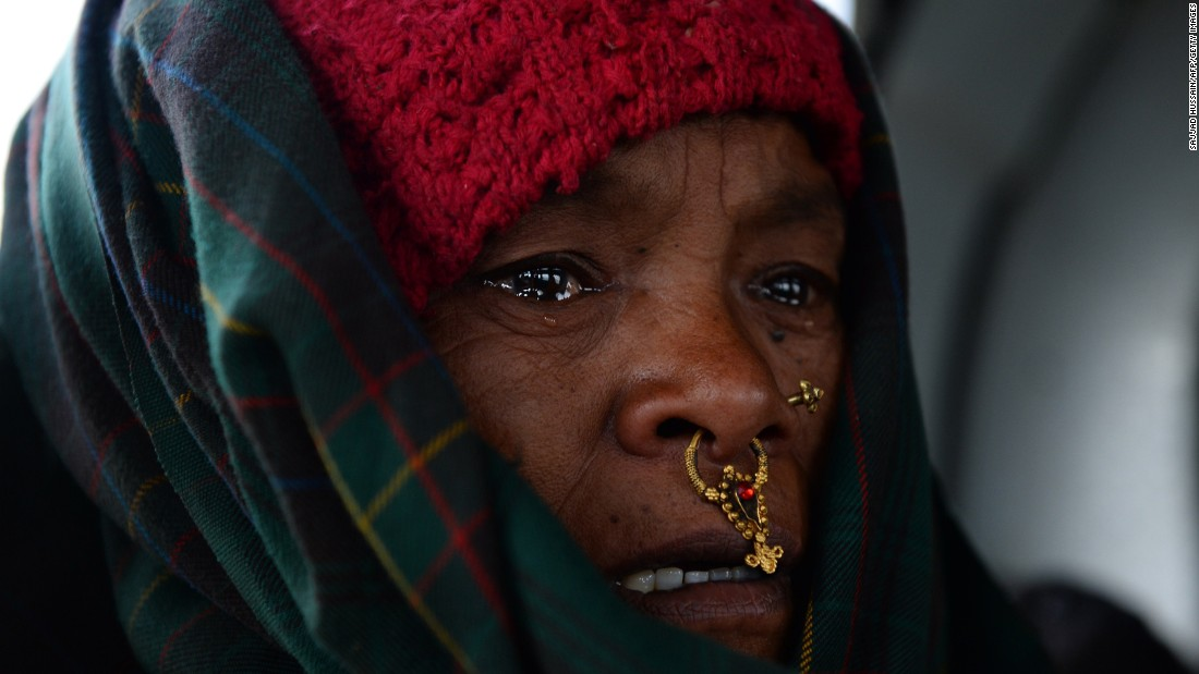 An injured Nepalese villager cries as she sits inside an Indian army helicopter after she was rescued from Baluwa on Friday, May 1. The earthquake's death toll has climbed above 7,800.