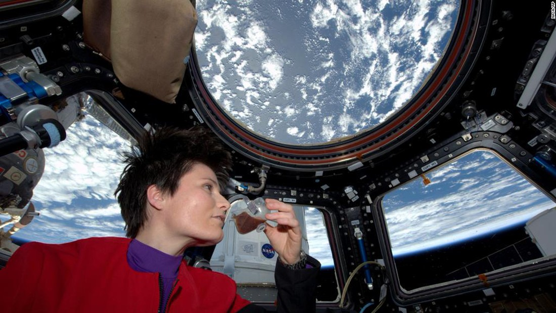 Italian astronaut Samantha Cristoforetti sips espresso from a cup designed for use in zero gravity on the International Space Station on Sunday, May 3.