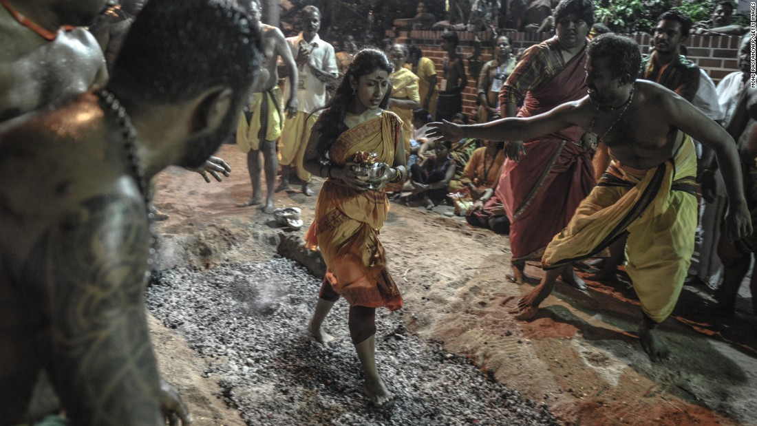 A Malaysian Hindu woman walks on hot coals during a firewalking festival at a temple in Kuala Lumpur on Sunday, May 3.