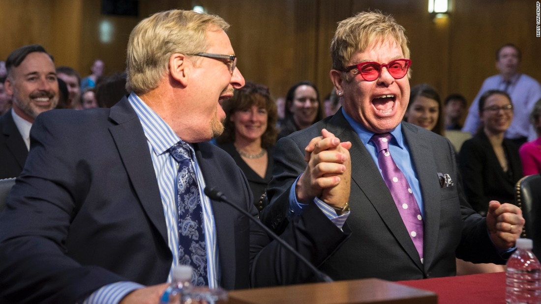 "Sir Elton John, right, greets pastor and author Rick Warren on Capitol Hill in Washington on Wednesday, May 6, before testifying before a Senate subcommittee in support of U.S. funding for global HIV/AIDS treatment. <a href=""http://www.cnn.com/videos/tv/2015/05/06/erin-intv-elton-john-aids-will-end-in-my-lifetime.cnn"" target=""_blank"">Elton John says</a> he believes AIDS will end in his lifetime."