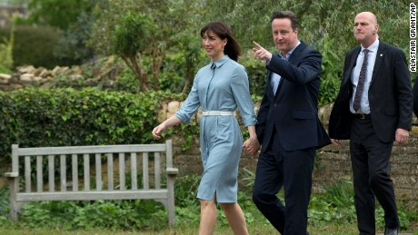 Britain's Prime Minister and Conservative Party leader David Cameron and his wife Samantha arrive to vote at a polling station in Spelsbury, England, as they vote in the general election, Thursday, May 7.