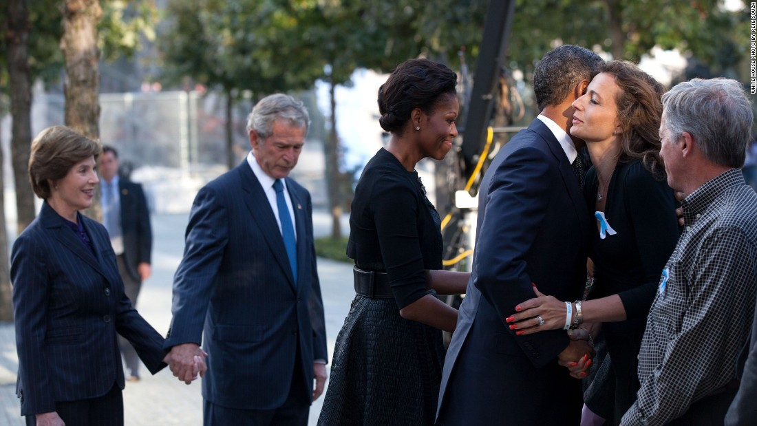 Greeting families with former first lady Laura Bush (from left), former President George W. Bush and first lady Michelle Obama before a commemoration ceremony on the 10th anniversary of the 9/11 terrorist attacks in New York on September 11, 2011.