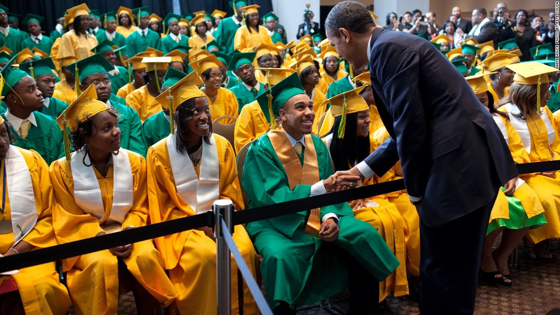 Shaking hands with Booker T. Washington students before their commencement ceremony in Memphis, Tennessee, on May 16, 2011.