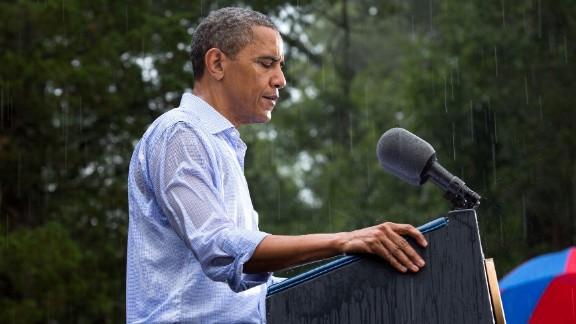 Speaking during a rainstorm in Glen Allen, Virginia, on July 14, 2012. Glen Allen is near Richmond.