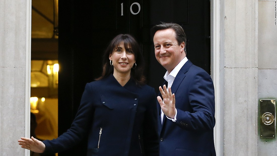 British Prime Minister David Cameron and his wife, Samantha, return to 10 Downing St. in London on Friday, May 8. With almost all the results in, Cameron and his Conservative Party have claimed an outright majority in Parliament, with 326 seats out of 650. He met with Queen Elizabeth II at Buckingham Palace on Friday -- a formal step toward forming a new government.