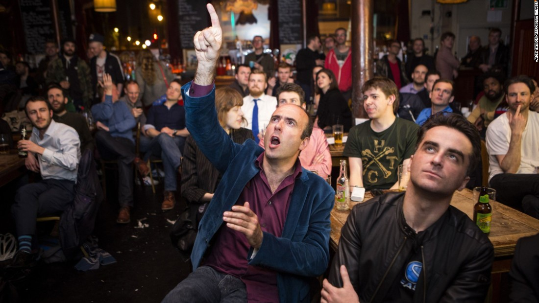 A man reacts in a pub in London as it is announced that London Mayor Boris Johnson won his seat in Parliament on May 8.