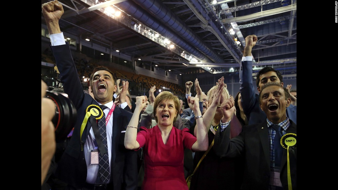 First Minister of Scotland and Scottish National Party leader Nicola Sturgeon, center, celebrates the results for her party in Glasgow, Scotland, May 8.