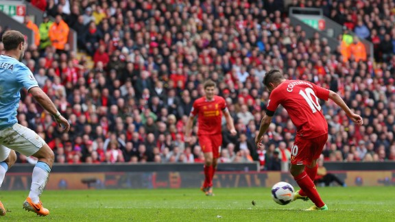 Coutinho swivels and scores what Luis Suarez thought was the goal of the 2013-2014 Premier League season against Manchester City.