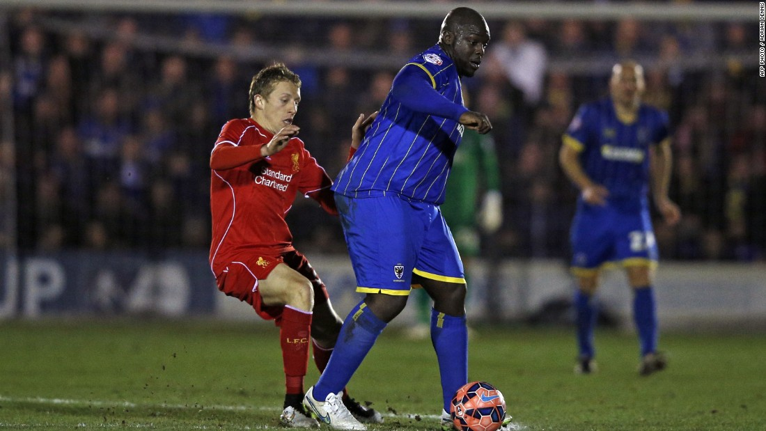 "English footballer Adebayo Akinfenwa is known as ""The Beast"" due to his imposing 105 kg (231 lbs) bulk. He plays in the lower leagues, now at AFC Wimbledon, and scored against top-flight team Liverpool in an FA Cup third-round match on January 5, 2015."