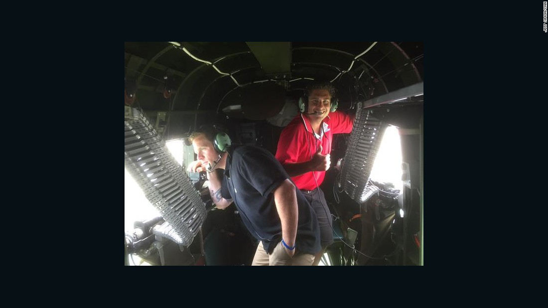 Two other riders film the B-25's flight.
