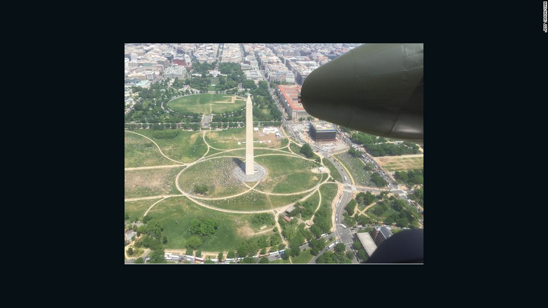 The Washington Monument and White House whoosh past below the B-25.