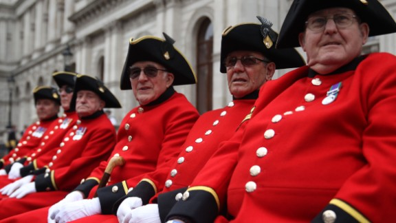 Chelsea pensioners sit on a bench for the V-E Day celebration in London.