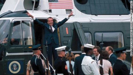 President Richard Nixon holds up V signs on the doorway of helicopter after leaving the White House following his resignation over the Watergate scandal on August 9, 1974.
