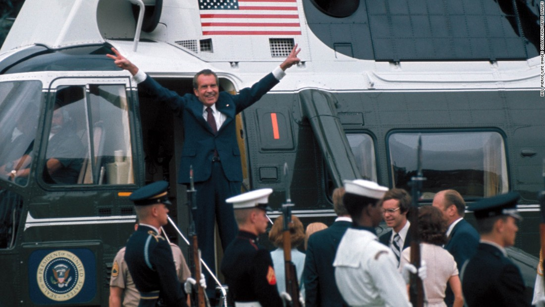 U.S. President Richard Nixon gestures in the doorway of a helicopter on August 9, 1974, after leaving the White House following his resignation over the Watergate scandal. Nixon's resignation marked the end to one of the biggest political scandals in U.S. history, which began in 1972 after a break-in at the Democratic National Committee's headquarters at the Watergate complex. Five men were arrested for the burglary, and the FBI and Washington Post reporters Bob Woodward and Carl Bernstein were able to trace them back to Nixon and the White House.