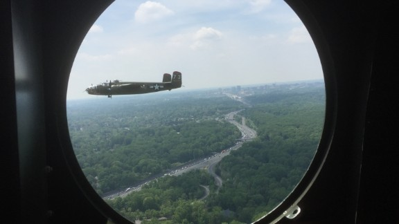 A B-25 bomber flies towards Washington, DC on May 8, 2015. Fifty-six World War II warbirds flew over the district to mark the 70th anniversary of VE Day, and the end of World War II.