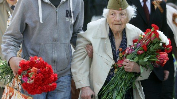 Visitors arrive to lay flowers near the tomb of the Unknown Soldier at the Antakalnis memorial during Victory Day celebrations in Vilnius, Lithuania, on May 9. Lithuania was part of the Soviet Union during World War II.