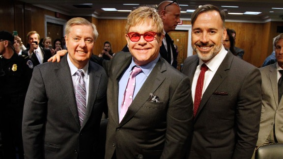 Graham; Sir Elton John, center; and filmmaker and John