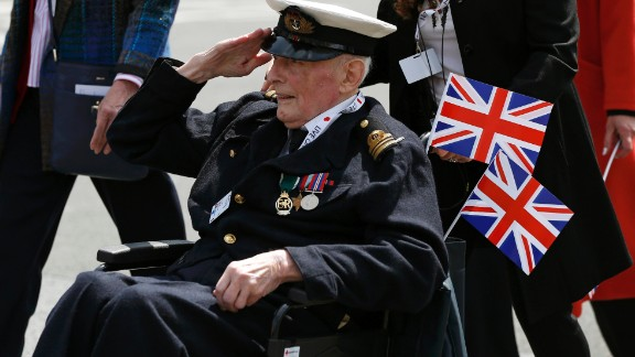 A veteran salutes during an armed forces and veterans
