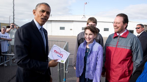 President Barack Obama, visiting Watertown, South Dakota, on Friday, May 8, shows off a note given to him by 11-year-old Rebecca Kelley. Rebecca had written him a letter asking him to visit South Dakota, which is the 50th state Obama has visited during his time in office. White House photographer Pete Souza highlights a picture from each state.