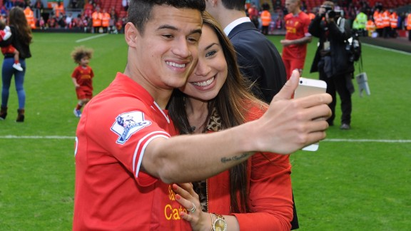 A selfie taken with wife Aine at Anfield during the 2013-14 end of season lap of honor. The pair are childhood sweethearts and she left everything in Brazil behind to support him when he moved to Europe.