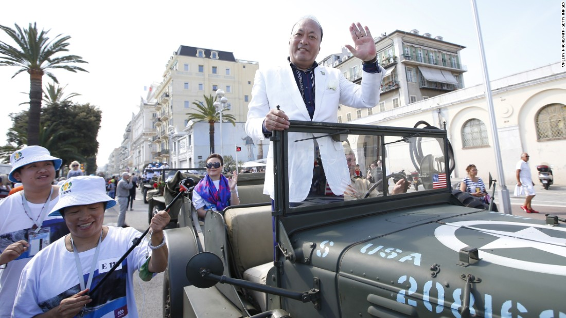 Li Jinyuan waves to the crowds in a parade on May 8 in Nice, France.