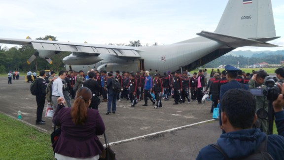 Fishermen board a Thai military plane in Ambon, Indonesia on April 9 during their repatriation.