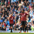 QPR players dejected Manchester City