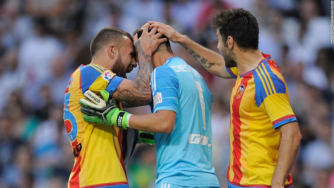 The Valencia goalkeeper is congratulated by his teammates as his save earned the visitors a valuable point as they continue to chase a Champions League place for next season.