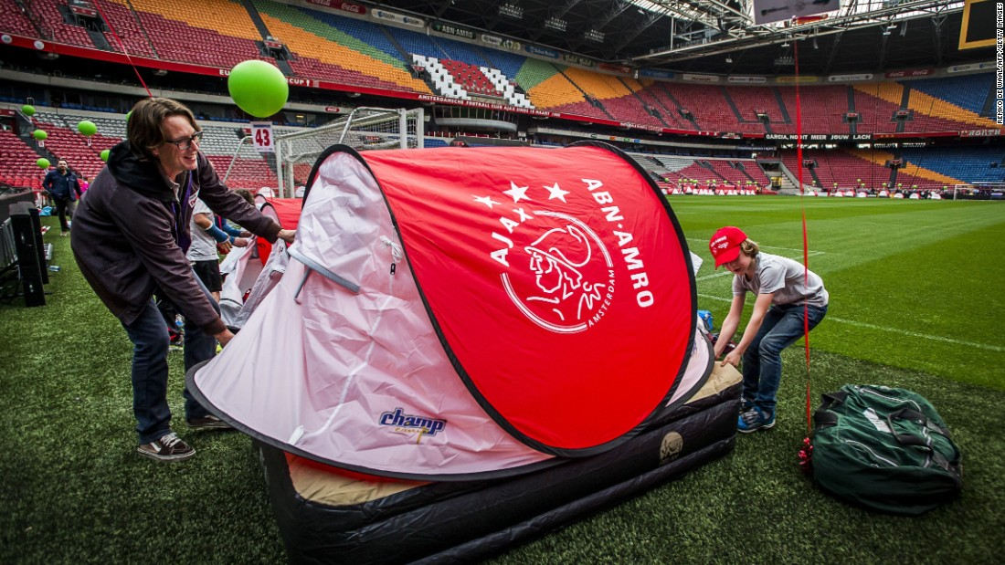 It was a family affair this weekend at Dutch club Ajax. The Amsterdam club's fans were invited to camp pitch side overnight prior to the team's match against Cambuur Leeuwarden. And on Sunday the Ajax players walked out with their mothers instead of mascots to celebrate Mother's Day in the Netherlands.