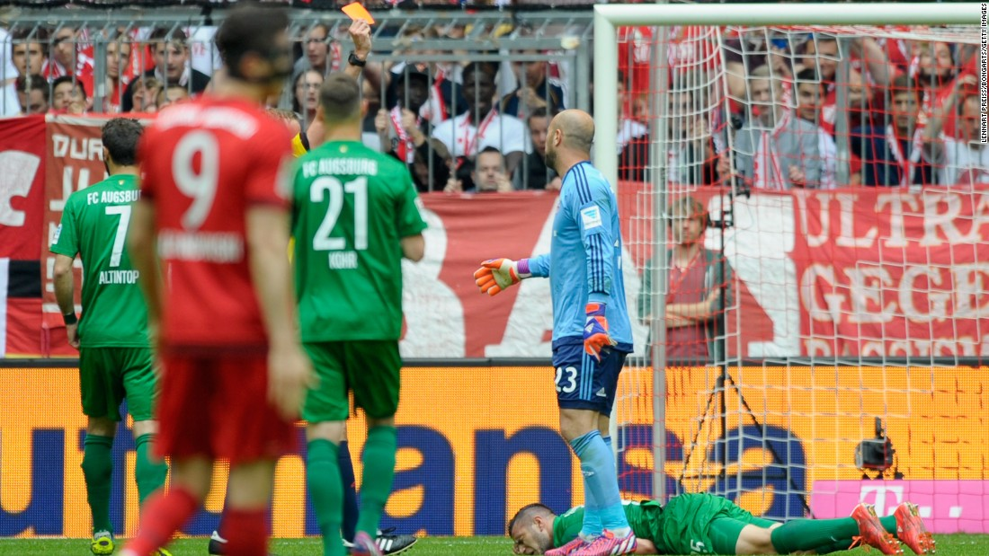 Bayern Munich's Pepe Reina is sent off after just 13 minutes in his side's 1-0 home defeat against Bundesliga rivals Augsburg. The German champions have now lost three games in a row and welcome Barcelona next looking to overturn a 3-0 first-leg deficit in their Champions League semi.