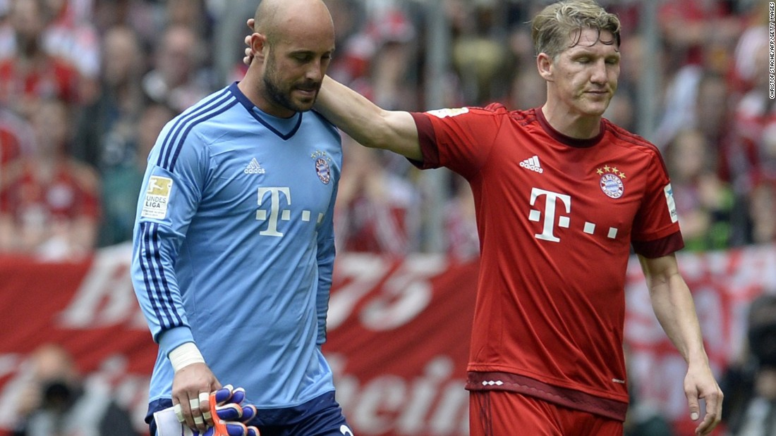 Bastian Schweinsteiger consoles Reina as he makes his way off the pitch. It was only the third game the Spaniard had played in all season.