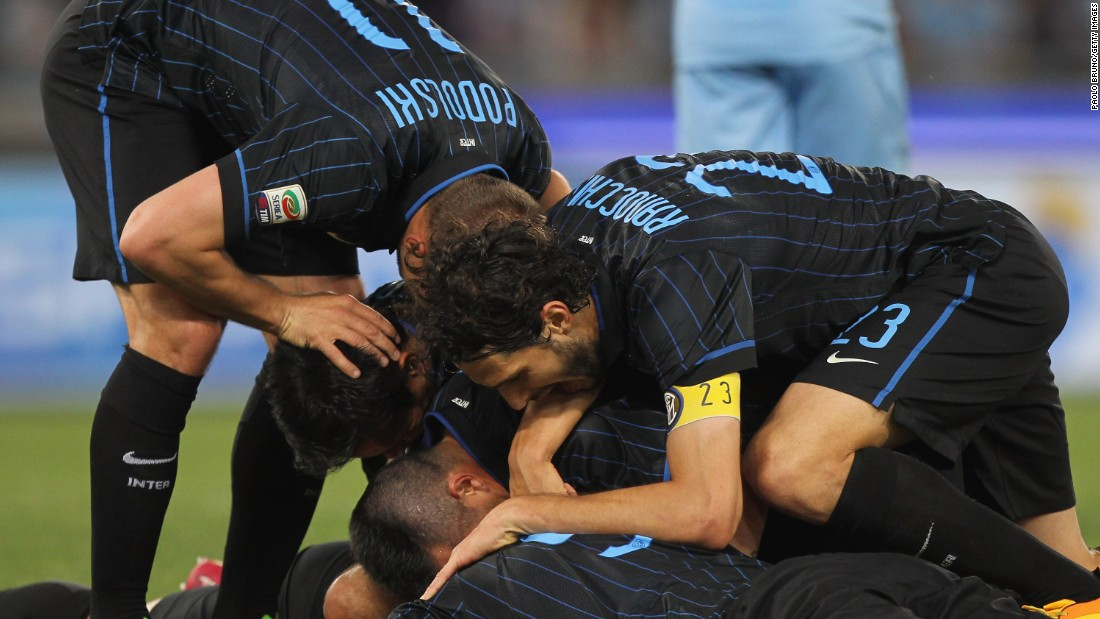 Inter Milan players mob Hernanes after his brace earned the team an important three points, keeping them in the hunt for a Europa League place.