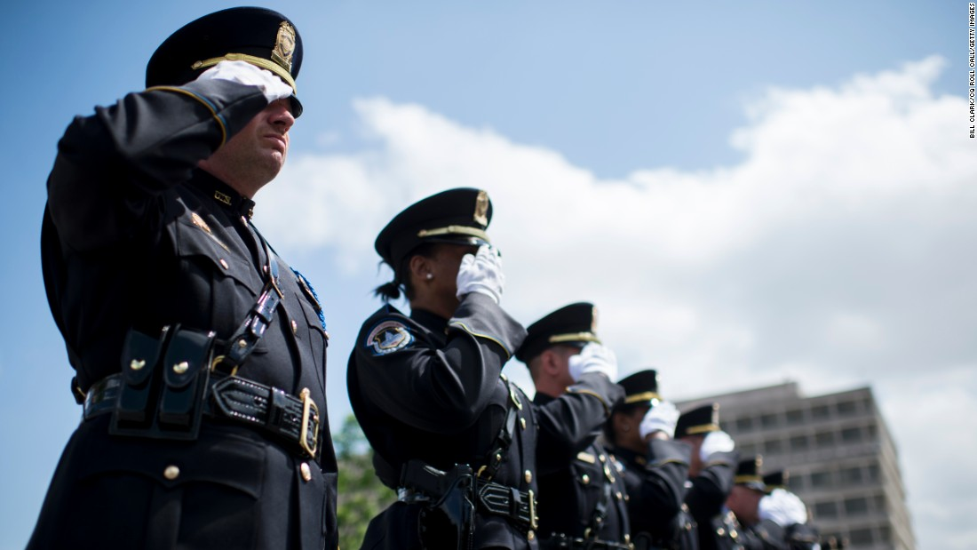 Honor guard members from the U.S. Capitol Police salute during the Washington Area Law Enforcement Memorial Service, which was held outside of D.C. Police headquarters on Monday, May 11. The event honored deceased local law enforcement officers. National Police Week runs through Saturday, May 16.