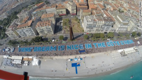 The Chinese company broke a Guinness World Record for building the largest human sentence in Nice, France.