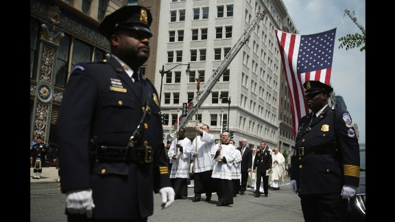 """The procession arrives at the annual Blue Mass on May 5. Law enforcement representatives gathered to continue the tradition of congregating annually """"to pray for their comrades who fell in the line of duty."""""""